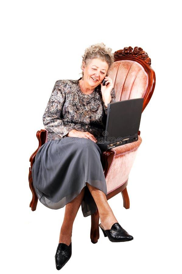 扶手椅子女商人 免版税库存图片