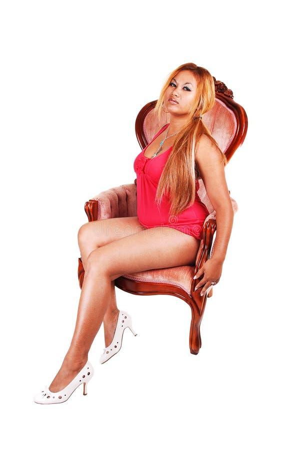 扶手椅子女孩头发的红色 免版税图库摄影