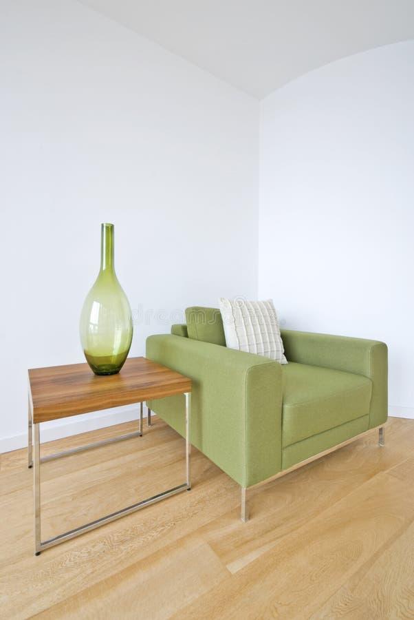 扶手椅子详细资料绿色生存现代空间 免版税库存图片