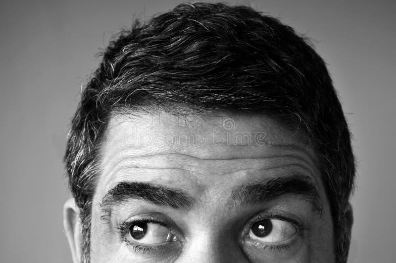 寻找某事的一个人的眼睛 库存照片