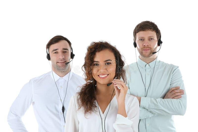技术支持队与耳机的在白色 库存图片