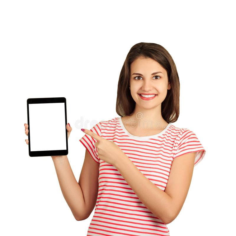 把手指指向的一个微笑的可爱的女孩的画象黑屏幕片剂计算机 在白色背景隔绝的情感女孩 免版税库存照片