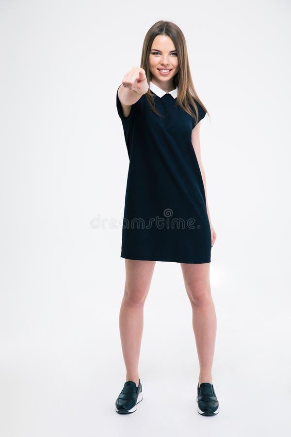 把手指指向的微笑的妇女照相机 免版税库存图片