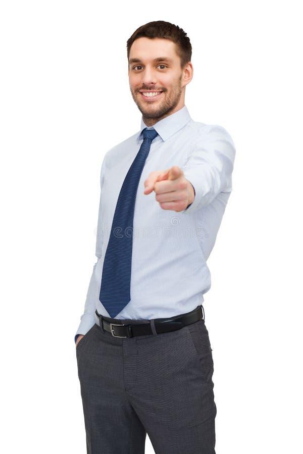 把手指指向的英俊的buisnessman您 免版税库存照片