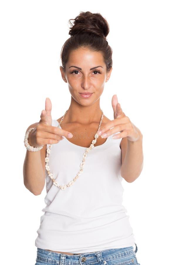 把手指指向的逗人喜爱的女孩您 免版税库存图片