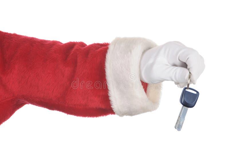 把握一套汽车关键的圣诞老人被隔绝在白色 仅手和胳膊 免版税图库摄影