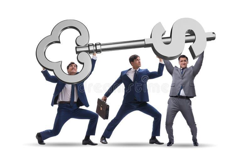 把握在财务概念的商人巨型关键 免版税图库摄影
