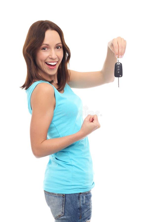 把握汽车关键的微笑的妇女 库存图片