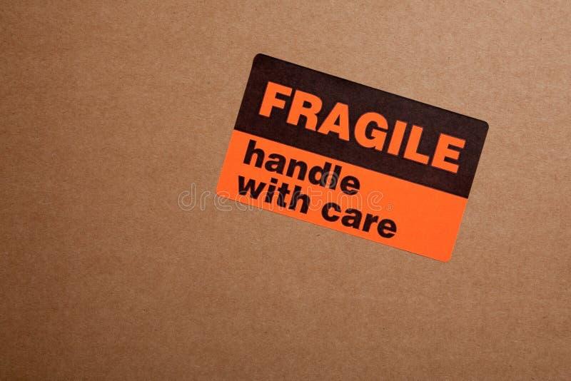 把脆弱的移动贴纸装箱 库存图片