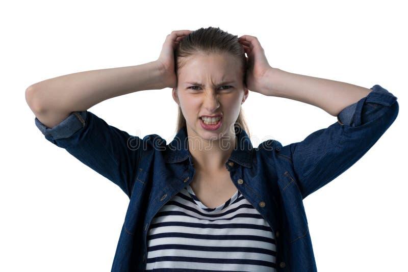 抓她的头的沮丧的十几岁的女孩 库存图片