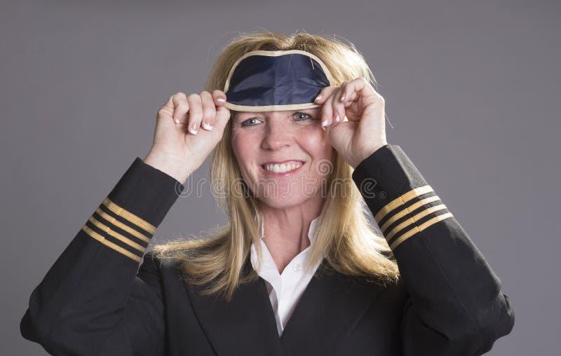 投入在眼睛树荫的机组乘务员官员 免版税库存照片