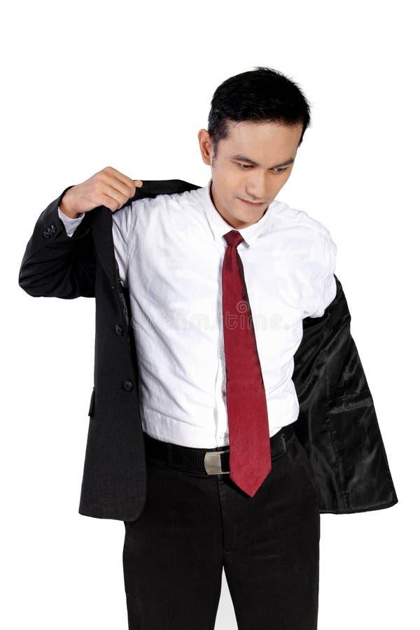 投入在衣服的年轻商人,隔绝在白色 库存照片