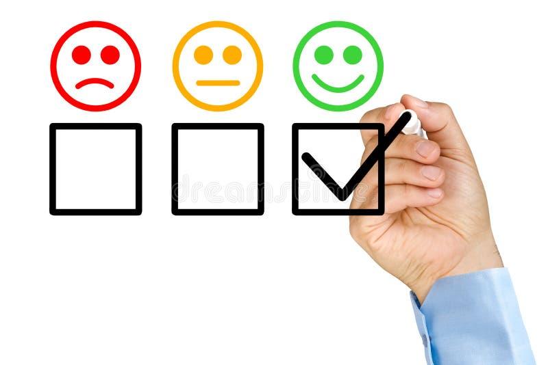 投入检查顾客服务评价表的手 库存照片