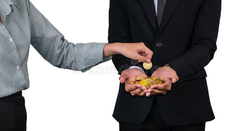 投入硬币的一只女性手 库存图片