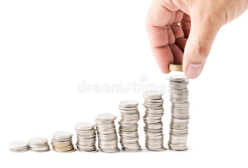 投入金钱硬币堆生长事务的男性手 库存图片