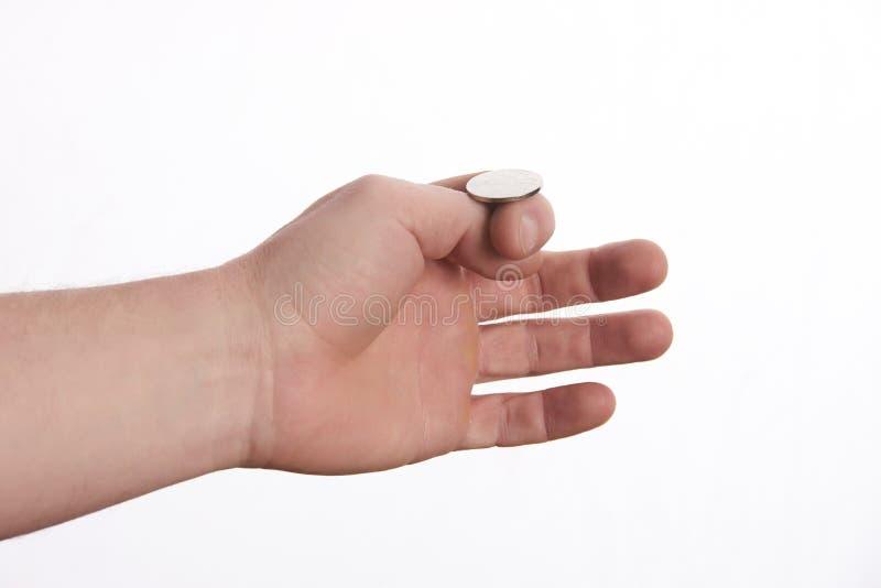 投掷硬币的商人手做出决定 库存图片