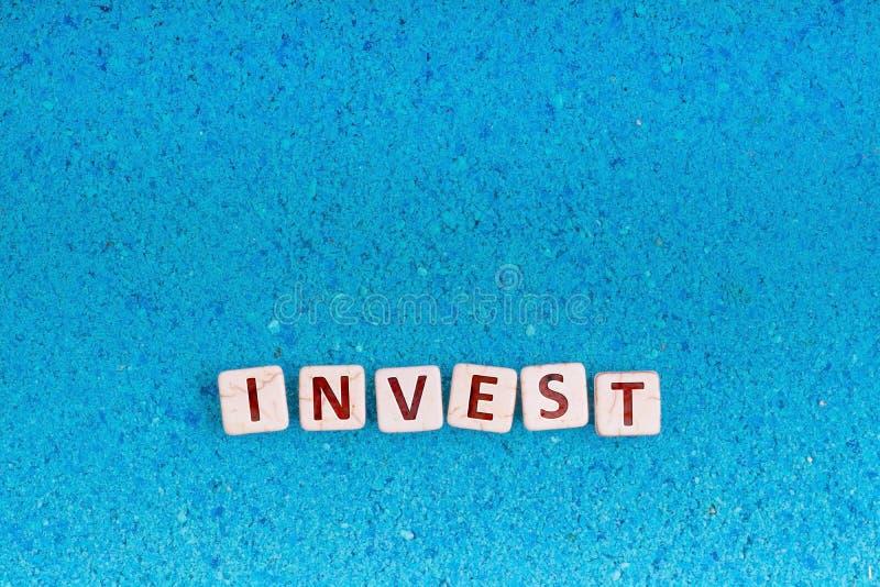 投资在石头的词 库存图片