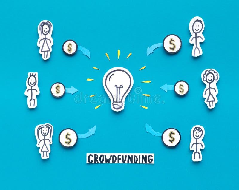 投资金钱的部份人民在蓝色的新的想法 库存照片