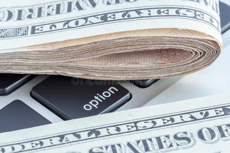 折叠在选择标志的美元钞票,事务 免版税库存图片