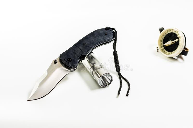 折叠的刀子和手电 小折刀和手电 库存图片