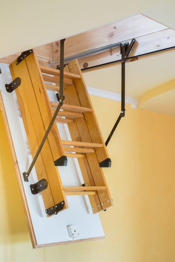 折叠的顶楼梯子 库存图片