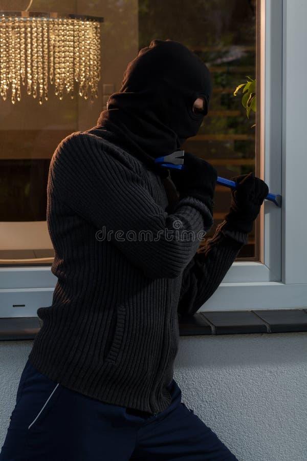 抢劫到房子里 库存照片