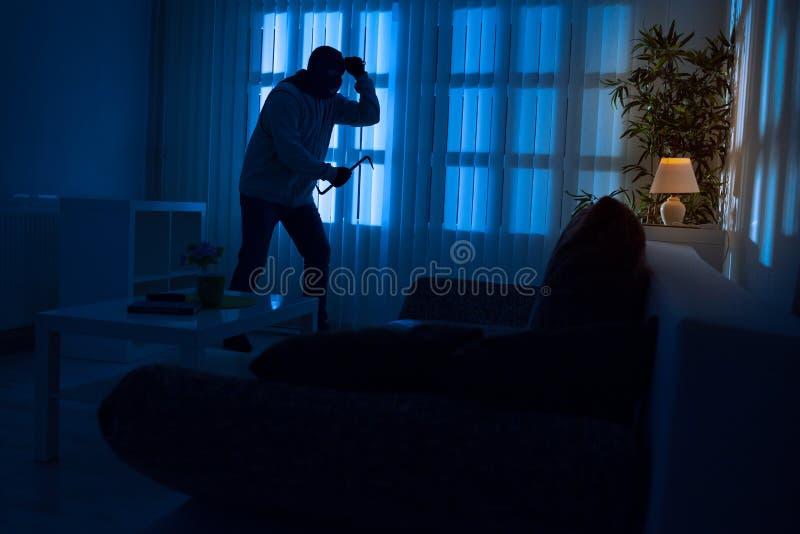 抢劫在家 免版税库存照片