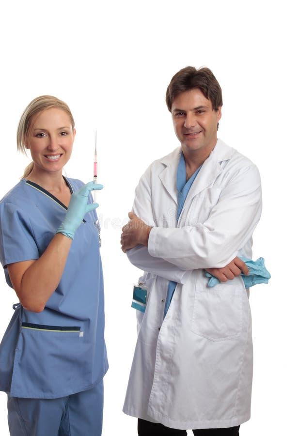 护士洗刷外科医生 库存照片