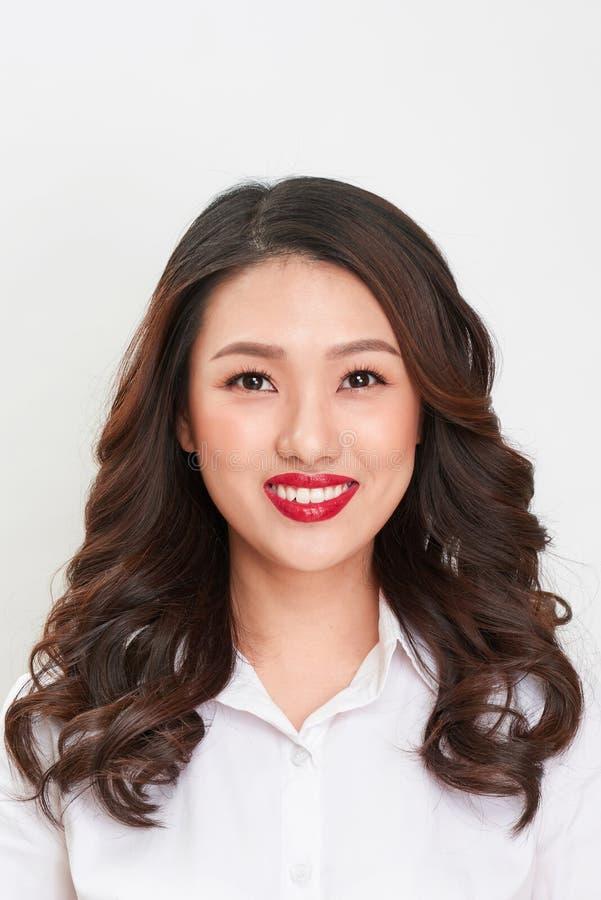 护照照片 亚裔微笑的妇女画象 库存图片