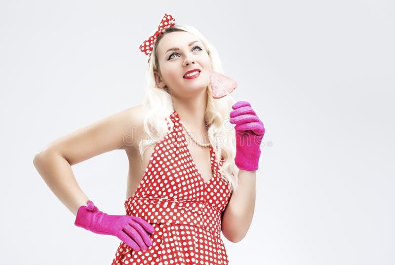 画报减速火箭的概念 作肉欲的有甜点的画报白肤金发的妇女 库存照片