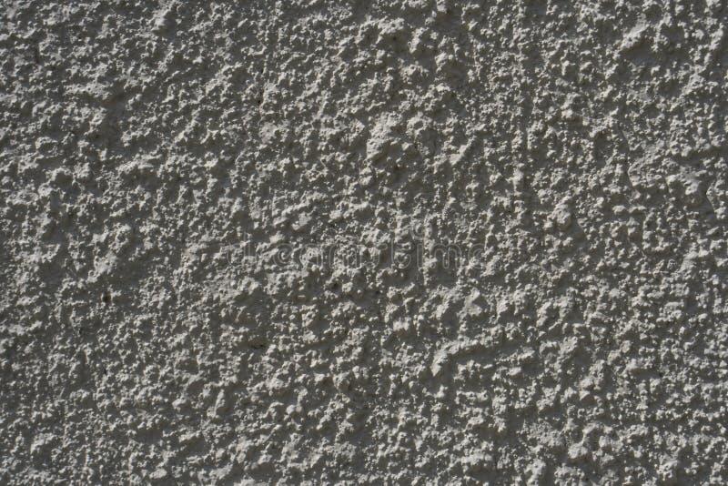 抨击的具体概略的沙子表面 免版税图库摄影