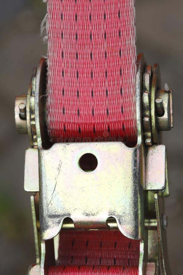 抨击皮带的棘轮 图库摄影