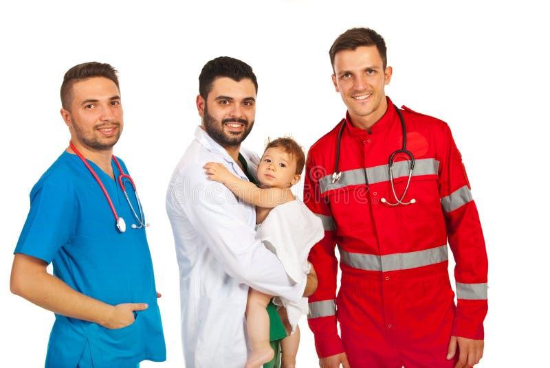 抱着婴孩的不同的医生 免版税库存照片