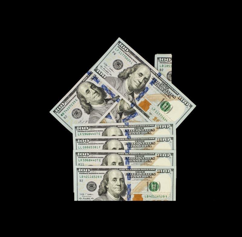 抵押和物产投资概念 美元金钱房子的现金模型黑背景的 免版税库存照片