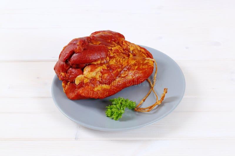 抽烟的肉猪肉 免版税库存照片
