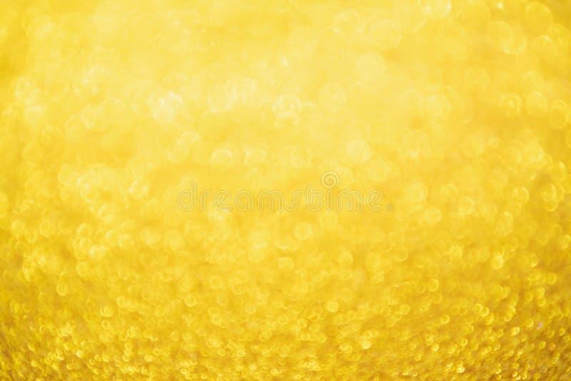抽象与bokeh的金子闪烁欢乐圣诞节纹理背景迷离 免版税图库摄影