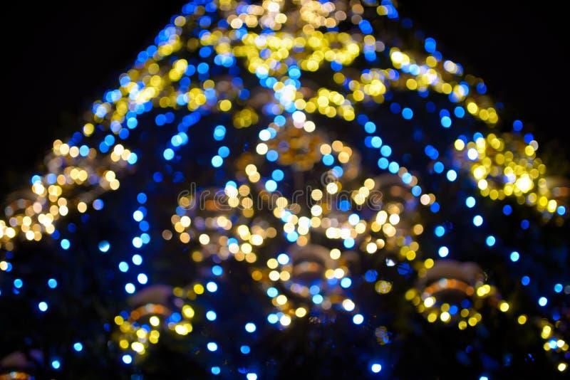 抽象五颜六色的光和闪烁bokeh光背景 库存图片