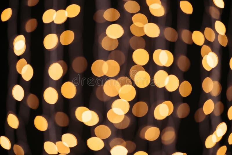 抽象光亮的金黄bokeh背景 免版税库存照片