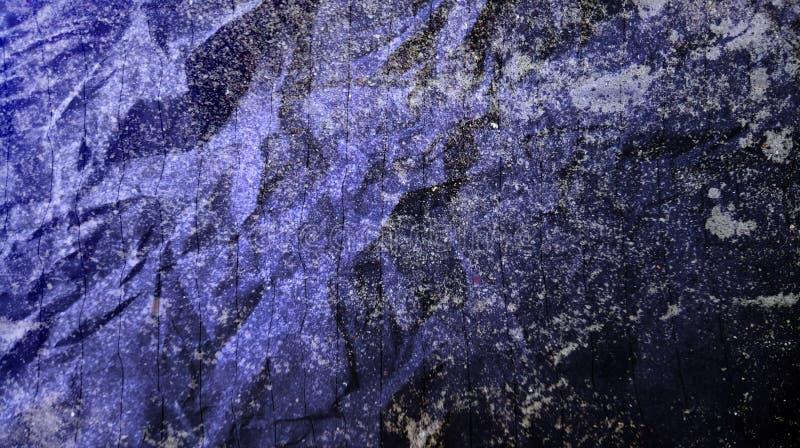抽象压皱纸黑淡色蓝色混合物多颜色作用墙壁纹理背景 库存图片