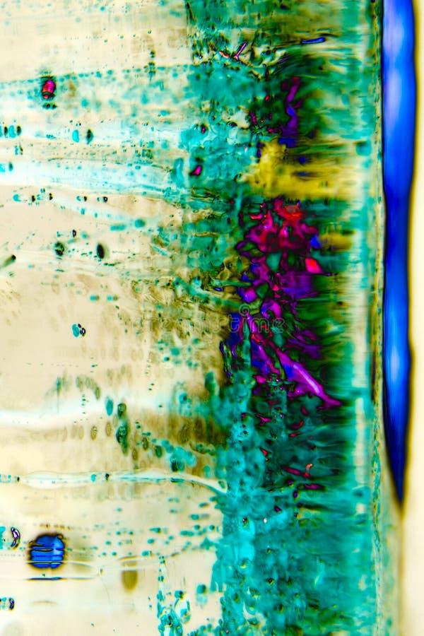抽象在冰的背景流动的颜色,熏制 库存照片