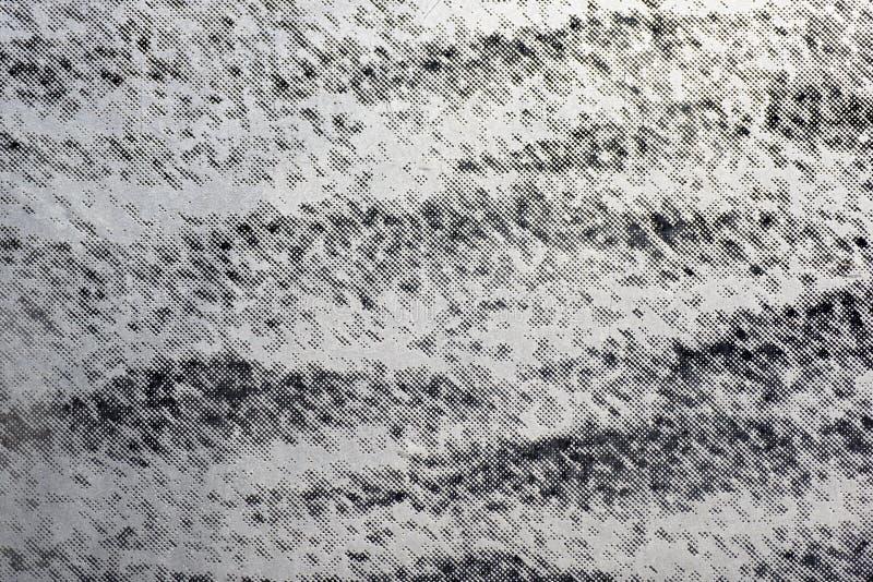 抽象在灰色颜色的小点织地不很细背景 免版税库存图片