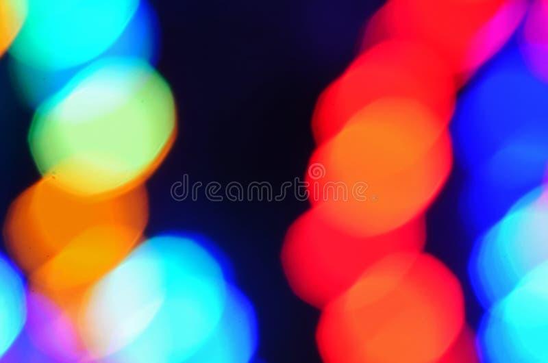 抽象多彩多姿的光bokeh背景墙纸 库存照片
