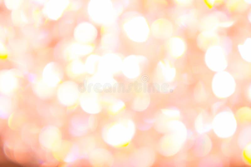 抽象照明设备bokeh颜色黄色和白色迷离背景 免版税库存照片