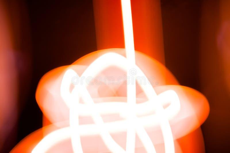 抽象种族分界线画与在黑背景freezelight摄影的蜡烛光 库存图片
