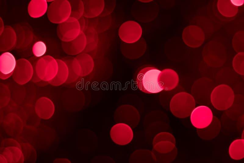 抽象红色和桃红色圆bokeh背景 库存图片