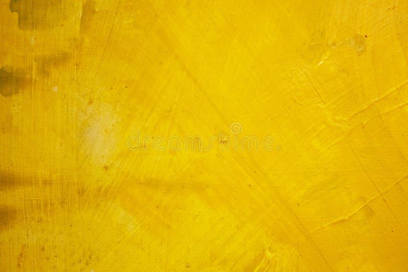 抽象绘画 与油的绘画在一个主要冲程的背景的帆布 着墨黄色 免版税库存图片
