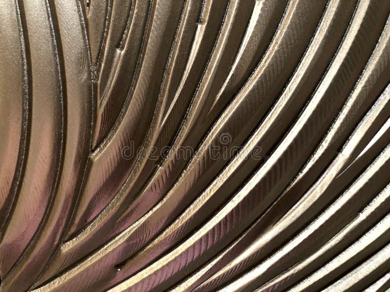 抽象背景弄脏了 被绘的表面上的很多发光的棕色容量弯曲的线 免版税库存图片