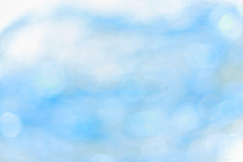 抽象背景蓝色bokeh 被弄脏的闪亮金属片圈子光  免版税库存照片