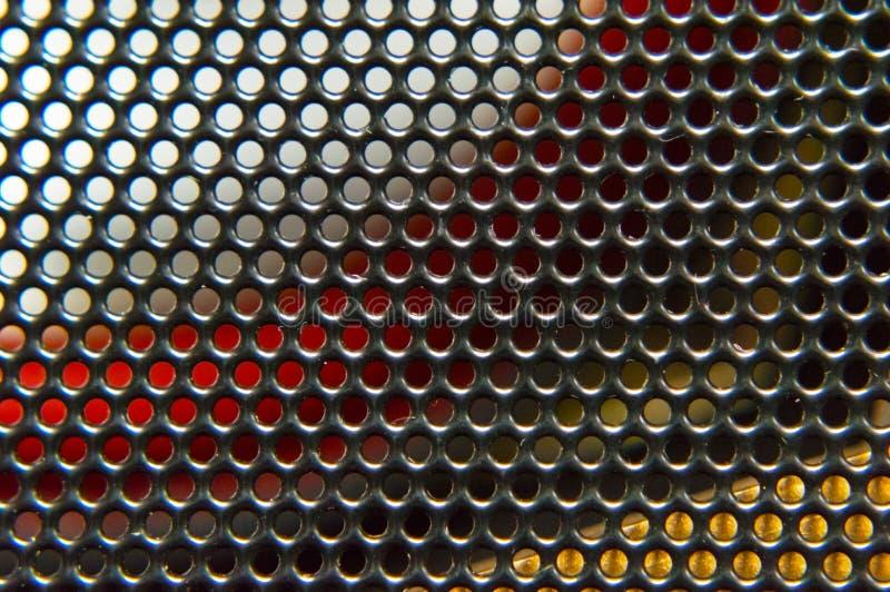 抽象色的背景金属栅格特写镜头 免版税图库摄影