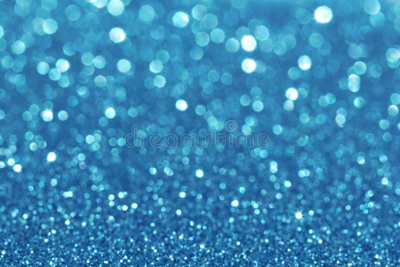 抽象蓝色闪烁发光的defocus光bokeh 库存图片